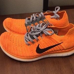 Orange Nike Free RN Flyknit